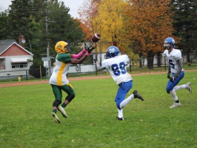 Richard Cole of King City Secondary School catches the ball during a game