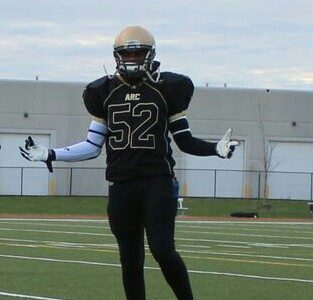 Fox 40 prospect Franck Kemayou on a football field