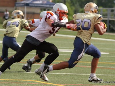 Jesse McQueen (54) of York Region Football makes a tackle during a game - Photo credit to Firedog Creative
