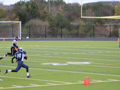 Ethan Brydon runs down the sideline during game
