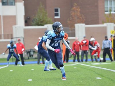 Nathan Passeri runs during a game of football