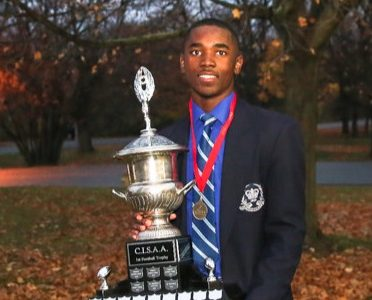 Rasheed Tucker holds the CISAA trophy
