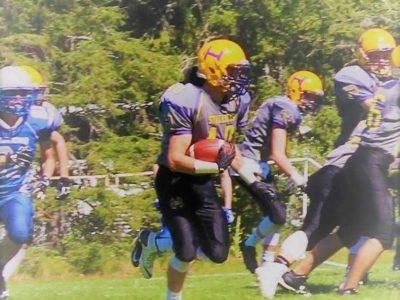 JV Linebacker Clayton Mrazek carries the ball on a Stallions trick play (credit: The Mrazek Family)