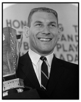 Russ Jackson with the Most Outsanding Player Trophy in 1966. Jackson is considered the greatest Canadian quarterback of all time, spending his entire career with the Ottawa Rough Riders winning three Grey Cups