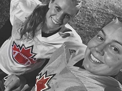 Alex (left) and Aimee share a selfie in their Team Canada jerseys (Image supplied by Alex Kowalski)
